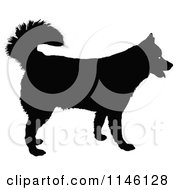 Clipart Of A Silhouetted Happy Husky Dog Royalty Free Vector Illustration