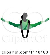Clipart Of A Silhouetted Gymnast Woman Balancing On Her Hands In A Green Leotard Royalty Free Vector Illustration by Lal Perera