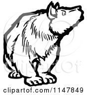 Clipart Of A Black And White Bear Looking To The Side Royalty Free Vector Illustration by Prawny Vintage
