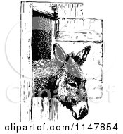 Clipart Of A Retro Vintage Black And White Donkey In A Stall Royalty Free Vector Illustration