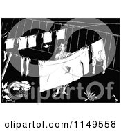 Clipart Of A Retro Vintage Black And White Woman Hanging Laundry Royalty Free Vector Illustration