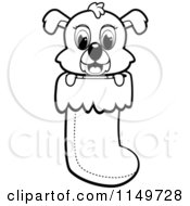 Cartoon Clipart Of A Black And White Cute Puppy Dog Peeping Out Of A Christmas Stocking Vector Outlined Coloring Page