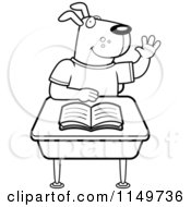 Cartoon Clipart Of A Black And White School Dog Raising His Hand And Sitting At A Desk Vector Outlined Coloring Page