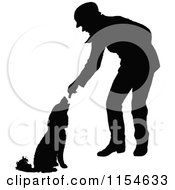 Clipart Of A Retro Vintage Silhouetted Man Feeding A Dog Royalty Free Vector Clipart