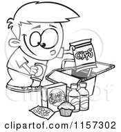 Cartoon Clipart Of A Black And White Boy Packing Junk Food Into A Picnic Basket Vector Outlined Coloring Page
