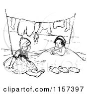 Clipart Of Retro Vintage Black And White Girls Playing In Sand Under Laundry On A Line Royalty Free Vector Illustration