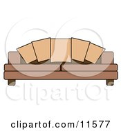 Couch Pillows On A Brown Sofa Clipart Illustration