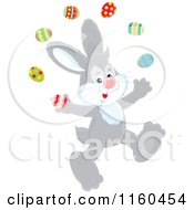 Cartoon Of A Gray Easter Bunny Juggling Eggs Royalty Free Vector Clipart