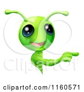 Cartoon Of A Cute Green Alien Looking Around A Sign And Pointing Royalty Free Vector Clipart