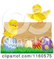 Cartoon Of Yellow Chicks And Easter Eggs On Grass By A Wood Sign Royalty Free Vector Clipart