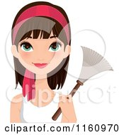 Pretty Brunette Woman With Green Eyes And A Pink Headband Holding A Feather Duster