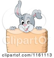 Cartoon Of An Easter Bunny Over A Sign Royalty Free Vector Clipart by visekart