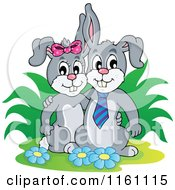 Cartoon Of A Happy Bunny Rabbit Couple By A Bush And Flowers Royalty Free Vector Clipart