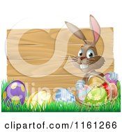 Cartoon of a Happy Easter Bunny Gathering Eggs in Front of a Wooden Sign - Royalty Free Vector Clipart by AtStockIllustration