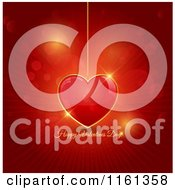 Happy Valentines Day Greeting And Red Pendant Heart Over Rays And Flares