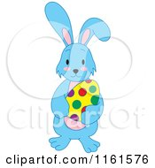 Cartoon Of A Blue Easter Bunny Holding A Polka Dot Egg Royalty Free Vector Clipart by Cherie Reve