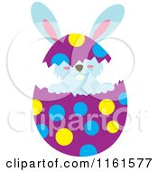 Cartoon Of A Blue Easter Bunny Playing In A Polka Dot Egg Shell Royalty Free Vector Clipart by Cherie Reve