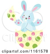Cartoon Of A Blue Easter Bunny Playing In A Polka Dot Egg Shell 2 Royalty Free Vector Clipart by Cherie Reve
