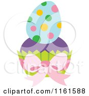 Cartoon Of A Polka Dot Easter Egg On A Cupcake Royalty Free Vector Clipart by Cherie Reve