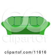 Green Coucn With Pillows In A Living Room