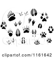 Clipart Of Black And White Animal Tracks And Prints Royalty Free Vector Illustration