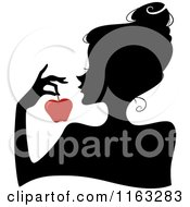 Cartoon Of A Silhouetted Woman Holding A Red Apple Royalty Free Vector Clipart