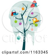 Cartoon Of A Frozen Bare Tree With Snow Christmas Baubles And Birds Royalty Free Vector Clipart