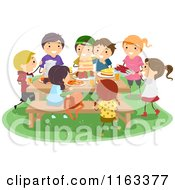 Cartoon Of A Group Of Happy Kids Having A Picnic Royalty Free Vector Clipart by BNP Design Studio