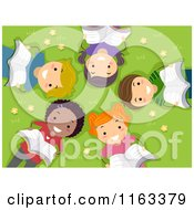 Cartoon Of Happy Diverse Children Reading And Laying On Grass In A Circle Royalty Free Vector Clipart