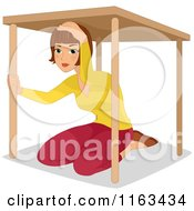 Woman Under A Table During An Earthquake Drill