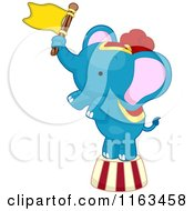 Cartoon Of A Blue Circus Elephant Balancing With A Flag Royalty Free Vector Clipart