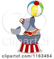 Cartoon Of A Circus Seal Balancing A Ball Royalty Free Vector Clipart