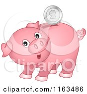 Pink Piggy Bank With A Silver Coin