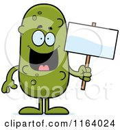 Cartoon Of A Pickle Mascot Holding A Sign Royalty Free Vector Clipart
