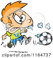 Cartoon Of A Frozen Boy Playing Soccer Royalty Free Vector Clipart