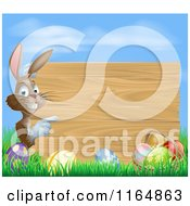 Cartoon Of A Brown Bunny Pointing To A Wood Sign Over Easter Eggs Royalty Free Vector Clipart