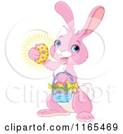 Cartoon Of A Cute Pink Easter Bunny Carrying A Basket And Holding A Glowing Egg Royalty Free Vector Clipart