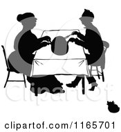 Clipart Of A Silhouetted Couple Cutting A Meal Royalty Free Vector Illustration
