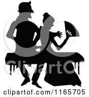 Clipart Of A Silhouetted Couple Sitting On A Bench Royalty Free Vector Illustration
