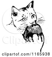 Clipart Of A Retro Vintage Black And White Cat With A Mouse Royalty Free Vector Illustration