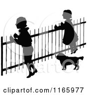 Clipart Of Silhouetted Children And A Dog At A Fence Royalty Free Vector Illustration