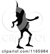 Clipart Of A Silhouetted Gnome Boy Walking Royalty Free Vector Illustration