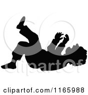 Silhouetted Boy Laughing On The Ground