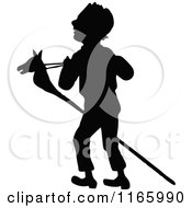 Silhouetted Boy With A Stick Pony