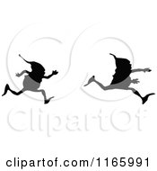 Clipart Of Silhouetted Gnome Boys Running Royalty Free Vector Illustration