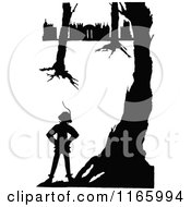 Clipart Of A Silhouetted Boy In The Woods Near A Castle Royalty Free Vector Illustration