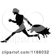 Silhouetted Farmer Carrying A Pig By Its Tail