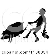 Silhouetted Farmer Carrying A Piglet And Tugging A String On A Pigs Foot