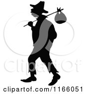 Clipart Of A Silhouetted Vagrant Man With A Sack Royalty Free Vector Illustration