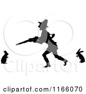 Clipart Of A Silhouetted Man Hunting Rabbits Royalty Free Vector Illustration by Prawny Vintage